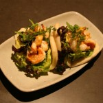 Ssam with grilled prawns, red onions and avocado with wild arugala and aji amarillo jang