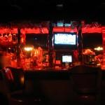 The dimly-lit bar.