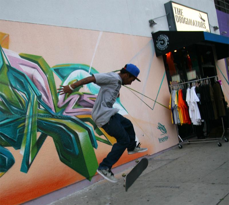 in front of the Originators store making art