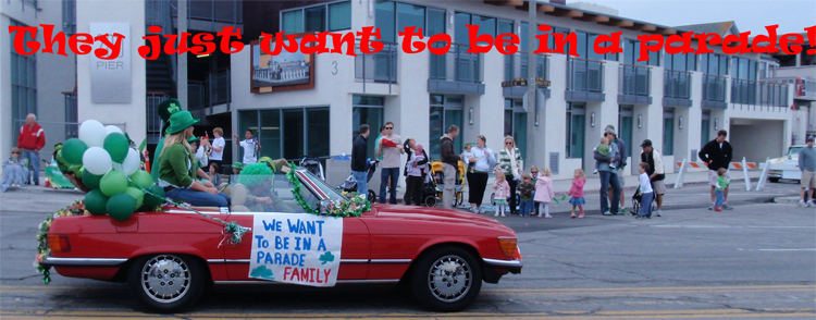 """Theis sign says: """"we want to be in a parade family"""""""