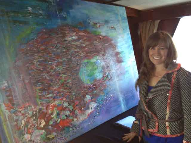 "Painter Dominique OValle with her piece ""Tasmen"""