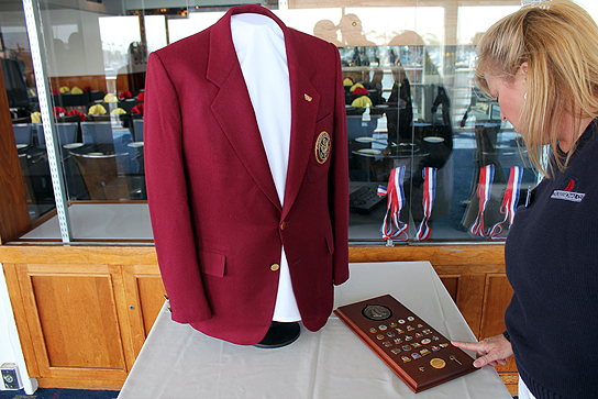 Along with a trophy and medals, the winning team is presented with burgundy jackets.