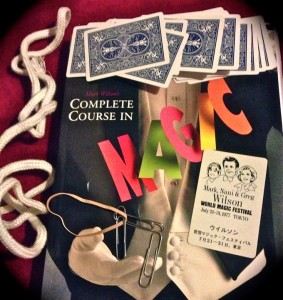 Mark Wilson's thorough textbook and some of the classes magic supplies (Photo by Nikki Kreuzer)