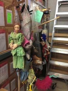 A rack of puppets hanging in the back storage room (photo by Nikki Kreuzer)