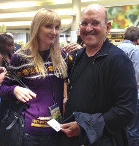 The author with co-owner Dell Furano. He is holding an Offbeat L.A. business card (photo courtesy of Nikki Kreuzer)
