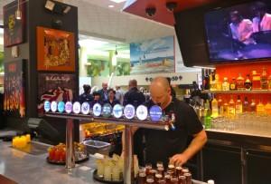 A bartender preparing mini cocktail samples at Rock & Brew (photo by Nikki Kreuzer)