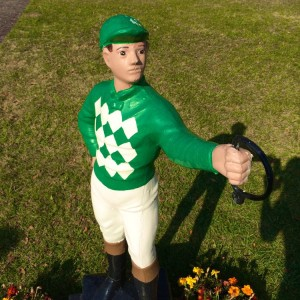 A lawn jockey oversees the central paddock lawn where racing horses warm up and cool down (photo by Nikki Kreuzer)
