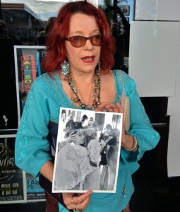Pamela Des Barres holds up a photo of the GTOs (photo by Nikki Kreuzer)