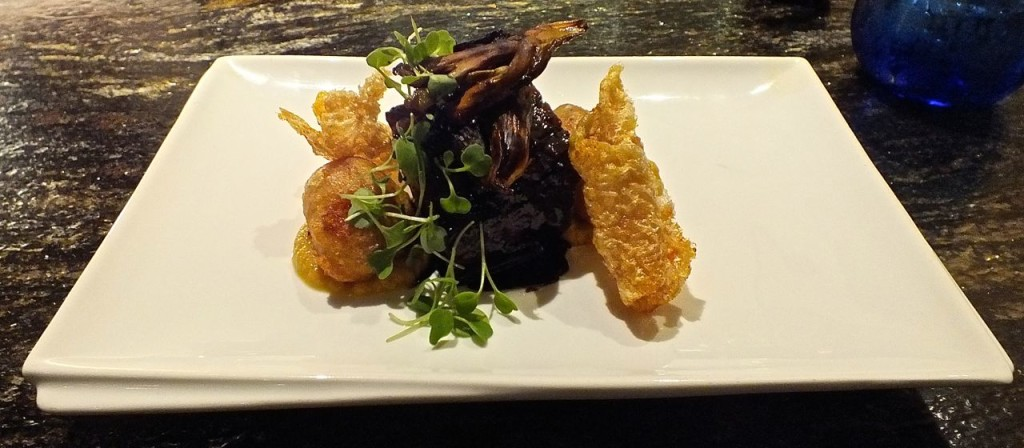 Pork belly with fried persimmon, a delectable pork dish at Broadway by Amar Santana