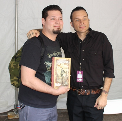 """Gris Grimly (right), film maker and fine artist, illustrator of """"Gris Grimly's Frankenstein"""" poses with a fan."""