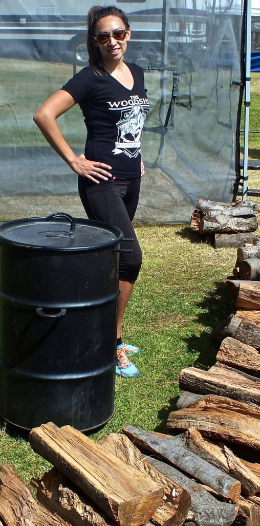 Renea Teasdale of Woodshed BBQ Team with wood for smoking.