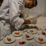 Chef Damon Gordon plating Wild Salmon Crudo with Fig Jam and Extra Virgin Olive Oil