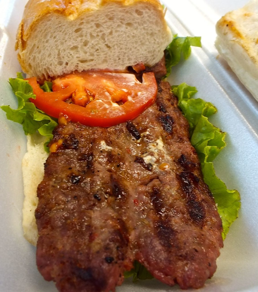 The choripan sausage sandwich, grilled fresh and a taste of the pampas. Photo by Edward Simon for The Los Angeles Beat.
