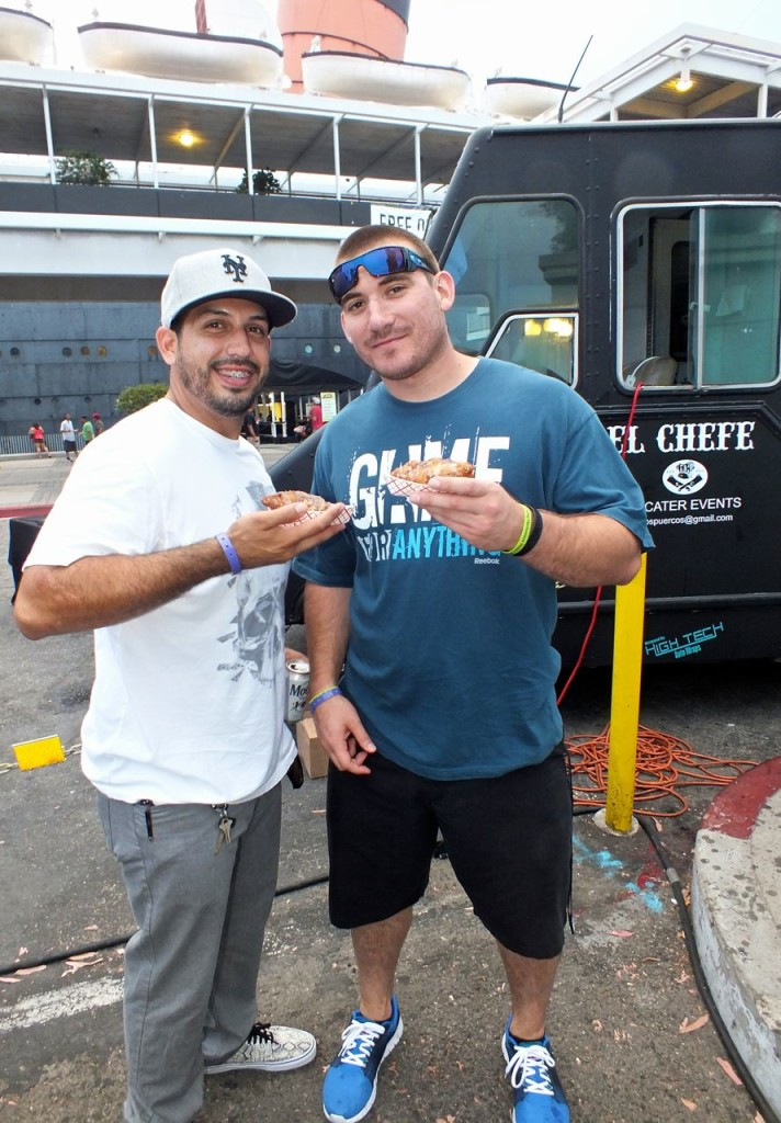 Mike and Evan loved their 'hog pockets' from the Dia de los Puercos Savage Chefs Grub Truck. Photo by Ed Simon for The Los Angeles Beat.