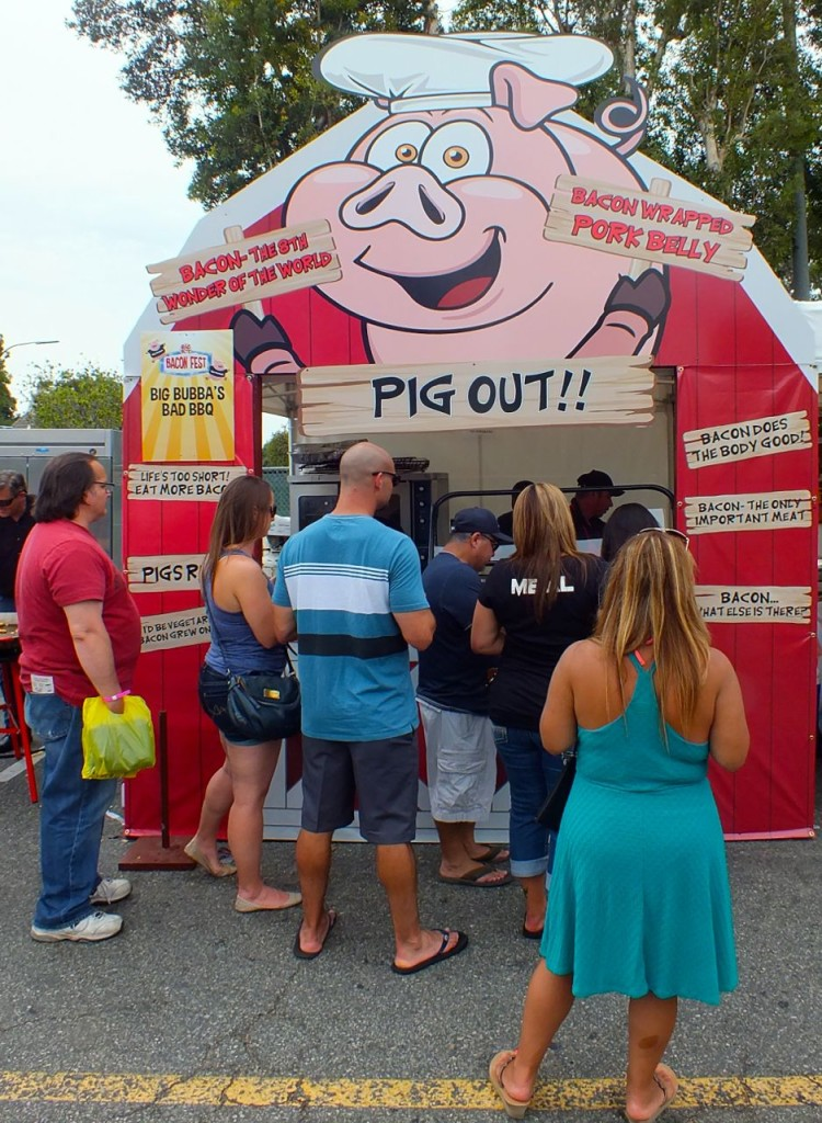 Who wouldn't want to get food from a stand called 'Pig Out'? Photo by Ed Simon for The Los Angeles Beat.