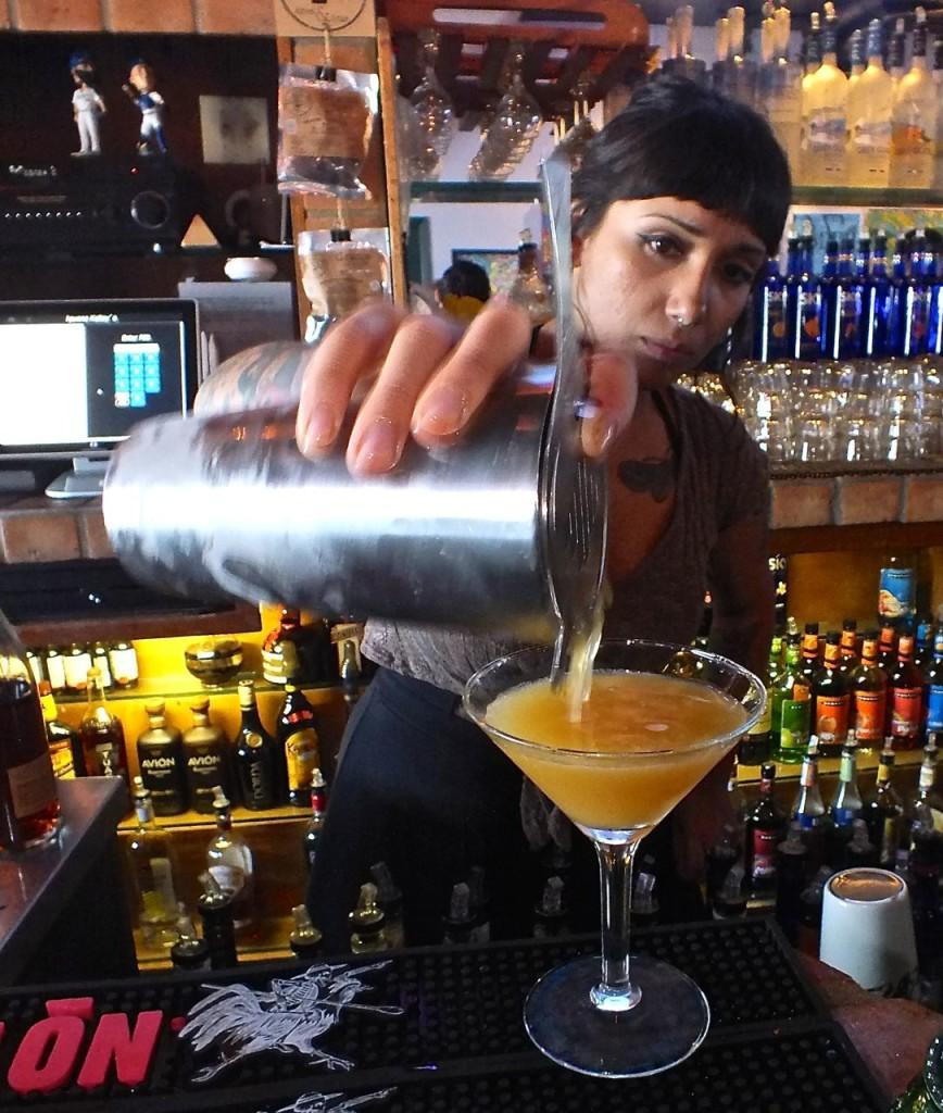 Denise pouring Bulleit Bourbon Sunrise. Photo by Edward Simon for The Los Angeles Beat.