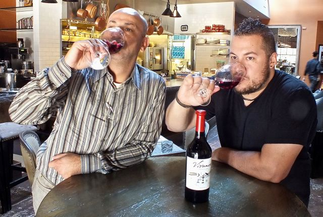 Ahmed and Amar drinking Sangria. Photo by Edward simon for The Los Angeles Beat.