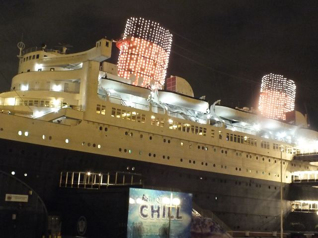 Queen Mary stacks lit 3 MCU. Photo by Edward simon for The Los Angeles Beat.