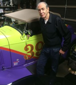 Robert Williams today with his fully restored 1932 Ford roadster, one of several vintage cars in his collection