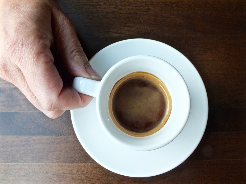 Hand CU Nicarauguan coffeee. Photo by Ed Simon for The Los Angeles Beat.