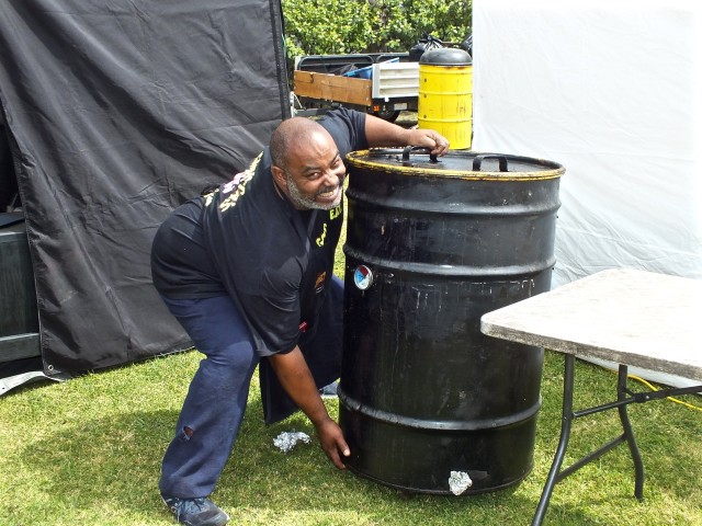 Neil clowns around except when it comes to cooking BBQ. Photo by Ed Simon for The Los Angeles Beat.