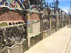The exterior wall of the towers, inlaid with melted glass fragments, tile and imprints (photo by Nikki Kreuzer)