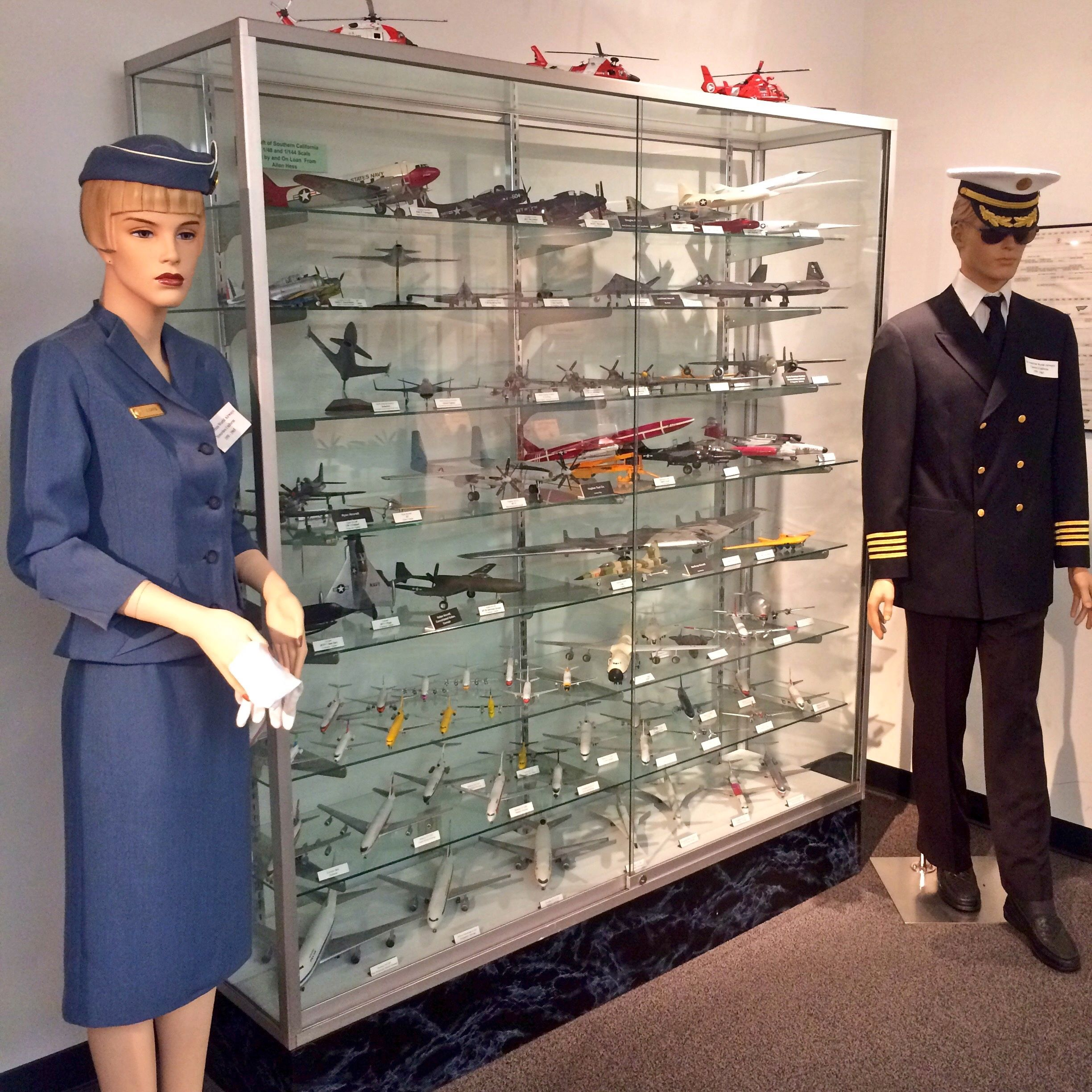 Vintage uniforms and model planes on display at the Flight Path Museum (photo by Nikki Kreuzer)