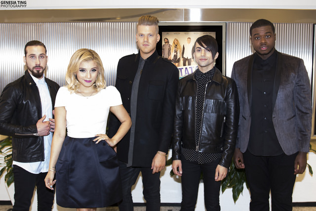 Pentatonix posing in front of their film poster. Photo by Genesia Ting for the Los Angeles Beat. [L-R: Avi Kaplan, Kirstin Maldonado, Scott Hoying, Mitch Grassi, Kevin Olusola]