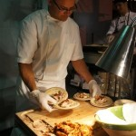 Chopping pork for Ford's Filling Station's Tacos