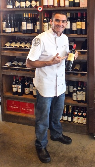 Laurent with bottle of wine. Photo by Ed Simon for The Los Angeles Beat
