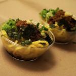 Tsujita's bowls of mazesoba: ramen noodles, seaweed, ground pork, garlic, onions.