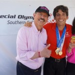 Richard and Gloria Pink with a medal winner in track & field at Pier del Sol