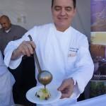 Chef Chef Andreas Nieto of LA Prime ladles red sauce at Pier del Sol