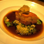 Crispy Pork Belly with Brussels Sprouts Kraut, Apple Onion Compote, and Rosemary Jus