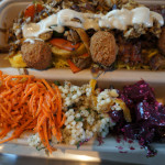A Yalla plate with shalafel, squash and rice
