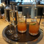 Champagne and Lucky Lindys made with Double Cross Vodka, Orange, Aperol, Kaffir Lime and Honey
