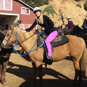 The author today, riding a Palomino named Savannah, at Sunset Ranch (photo by Juliet Cesario)