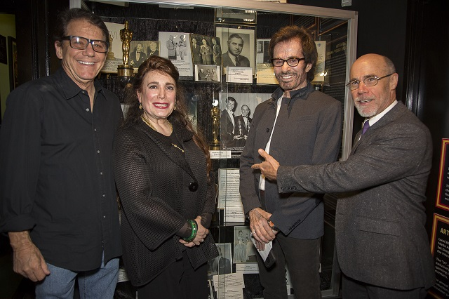 Anson Williams, Donelle Dadigan (Founder and President of The Hollywood Museum), George Chakiris, Barry Livingston in front of Oscar Display, Photo Courtesy of BHBPR