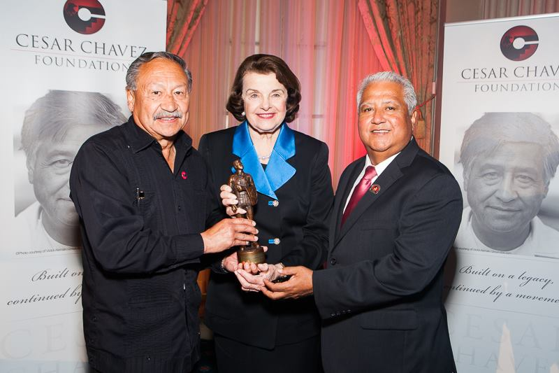 UFW President Arturo Rodriguez, Cesar Chavez Foundation President Paul Chavez present Senator Dianne Feinstein with her Cesar Chavez Legacy Award statuette on Thursday, March 31, 2016.