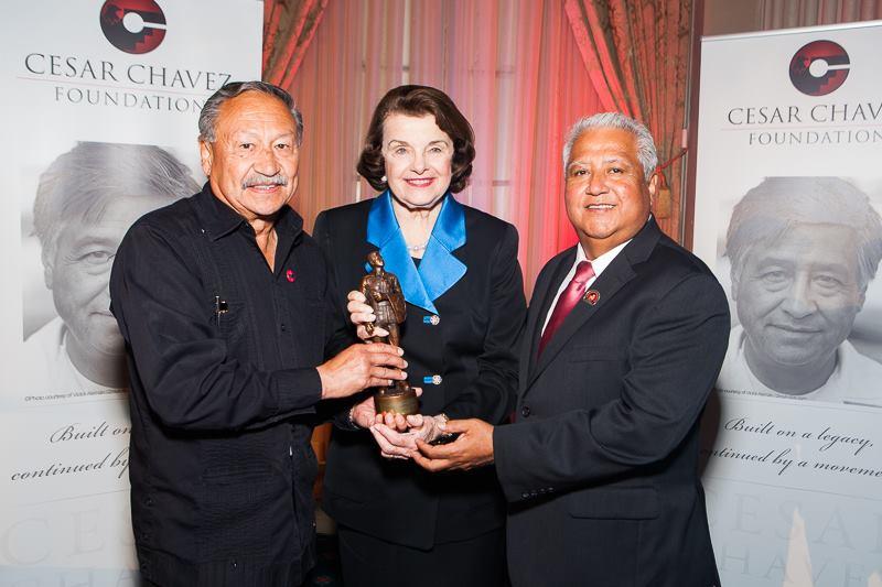 UFW President Arturo Rodriguez, Cesar Chavez Foundation President Paul Chavez present Senator Dianne Feinstein with her Cesar Chavez Legacy Award statuette on Thursday, March 31, 2016.