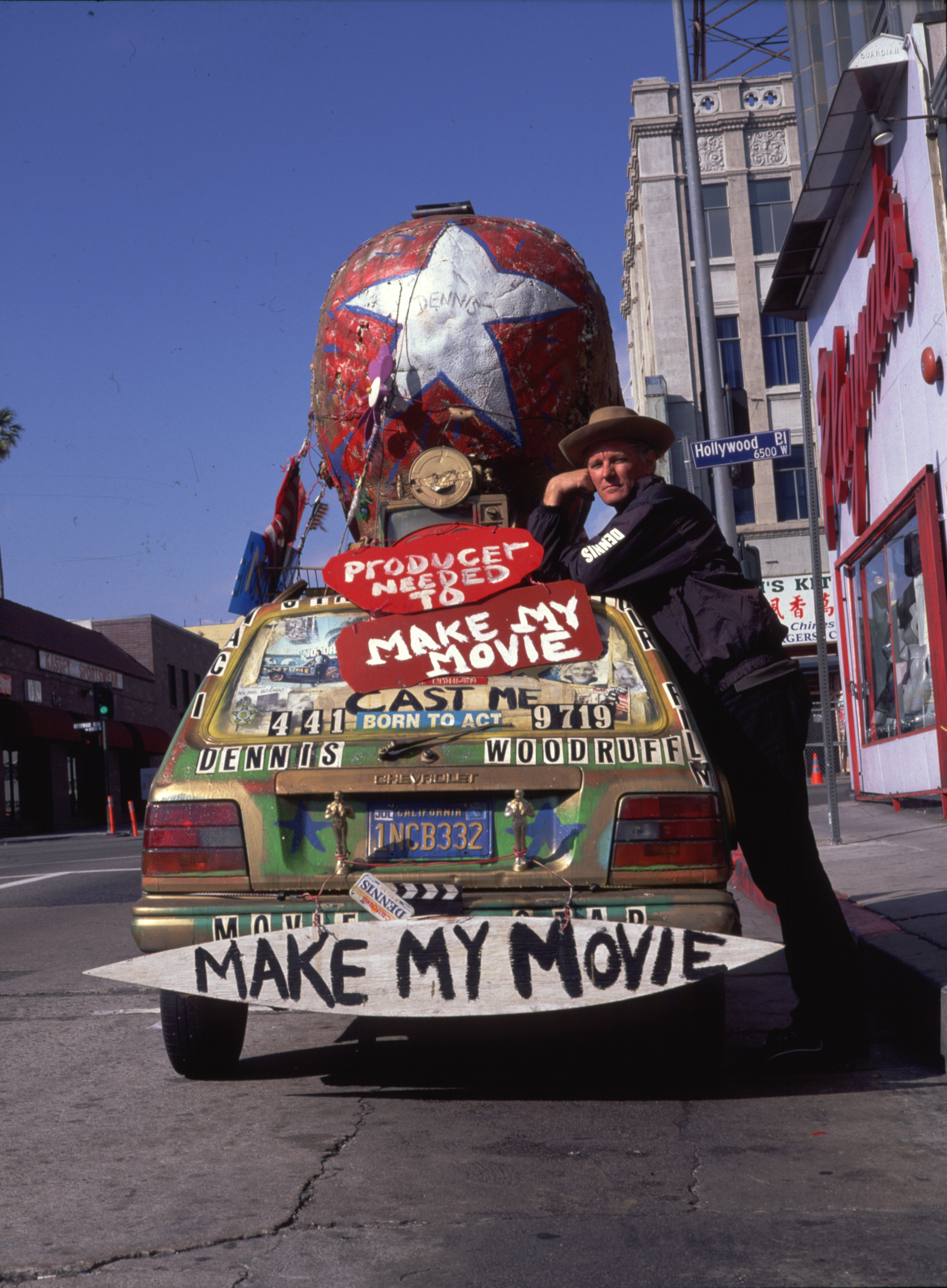 Dennis Woodruff with one of his fabulous art cars. Photo by Harrod Blank at www.artcaragency.com