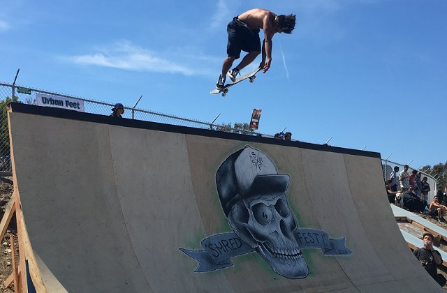 Skater rips a rocket air on the big half pipe. (photo by John Collinson)