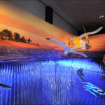 Two Thalassodromeus pterosaurs with impressive 14-foot wingspans swoop down to catch Rhacolepisfish in their toothless jaws in this large diorama showing a detailed re-creation of a dramatic Cretaceous seascape located at the present-day Araripe Basin in northeast Brazil.  Photo ©AMNH/R. Mickens