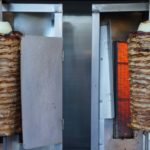 Spit roasting meat for tacos al pastor from King Taco