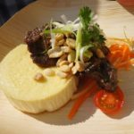 . Alex Pineda of Scampo's grilled Thai-style salt-cured short rib with coconut sfromato with a fresh papaya salad