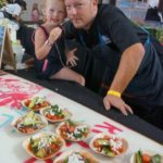 Chef Jason Neroni of Rose Cafe and helper
