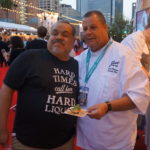 Chef Andre Bienvenu of Joe's Crab Shack with a fan