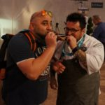 Chefs Duff Goldman and Bruce Kalman re-enacting the classic scene fro Lady and the Tramp. But with an octopus