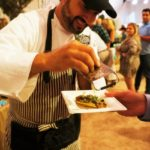 Mark Mollicha of La Vecchia Cucina shaving truffles onto his portabella mushroom ravioli