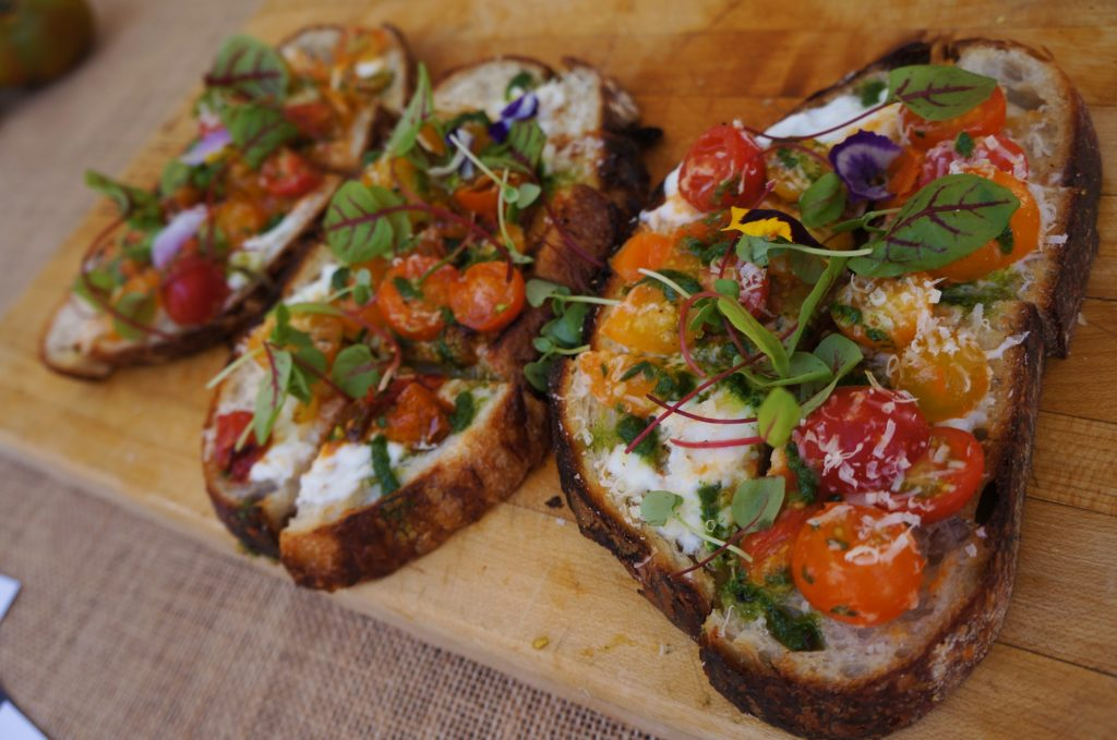 Fresh sourdough topped with burrata and sun gold tomatoes from Manhattan House (All photos by Elise Thompson for The LA Beat)